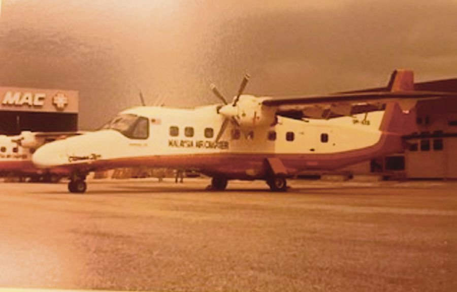 A Dornier Do228 aircraft at Malaysia Air Charter's parking bay at Sultan Abdul Aziz Shah Airport in Subang, Selangor, in the 1970s.