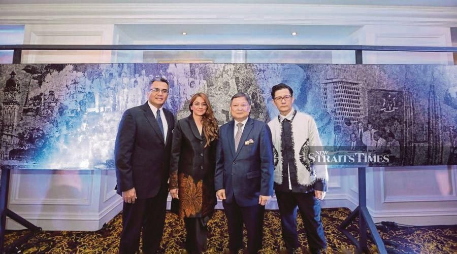 Indah Atelier founder and chief executive officer Mathumathi Manickvasagar Pilay (second from left) with Malaysia External Trade Development Corp export promotion and market access division senior director Abu Bakar Yusof (second from right) and KL Fashion Week chief executive officer Andrew Tan (right) at the launch of the Malaysia in 100m of Batik Pointillism project in Kuala Lumpur yesterday. -NSTP/ Nurul Syazana Rose Razman