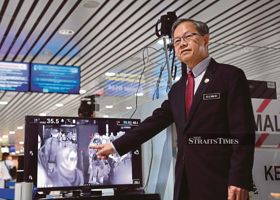 Deputy Health Minister Dr Lee Boon Chye showing a thermal scanner to screen travellers at the Kuala Lumpur International Airport, Sepang, yesterday. - Bernama