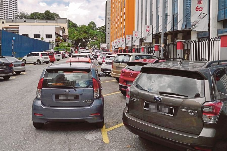 Cars double-parking near Jalan Riong, Bangsar, Kuala Lumpur. The authorities say their enforcement officers conduct clamping operations only once every six days.