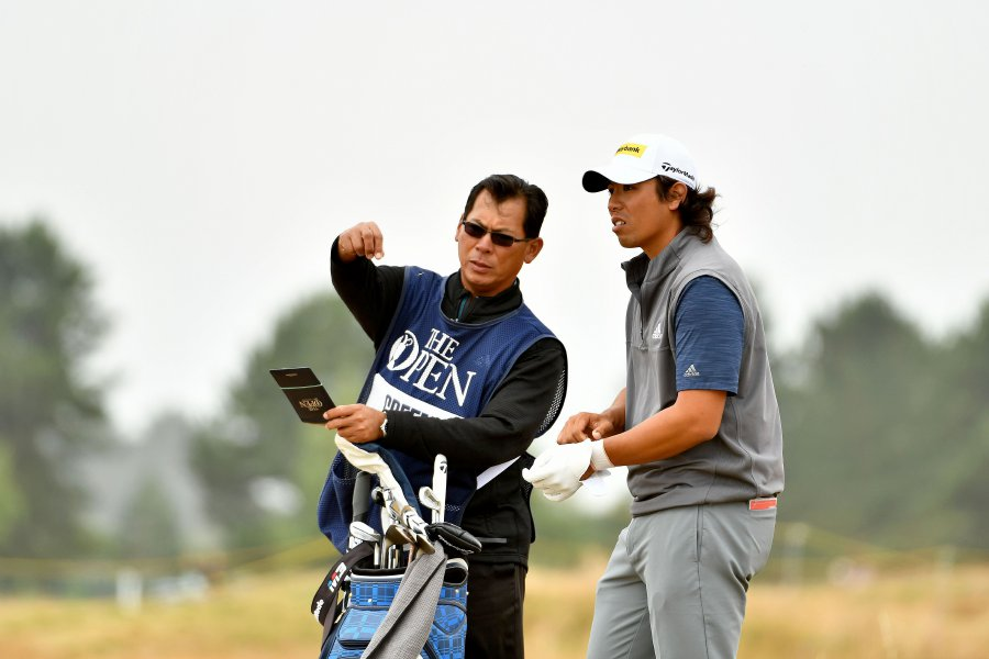 This handout from the Asian Tour taken and released on July 21, 2018 shows Gavin Green of Malaysia speaking to his caddie during round three on day 3 of The 147th Open golf Championship at Carnoustie, Scotland. AFP PHOTO / ASIAN TOUR
