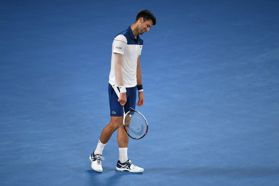 Serbia's Novak Djokovic reacts during their men's singles fourth round match against South Korea's Hyeon Chung on day eight of the Australian Open tennis tournament in Melbourne. AFP