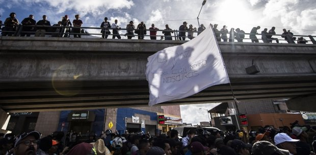 Migrants camp on bridge between Guatemala and Mexico as U S