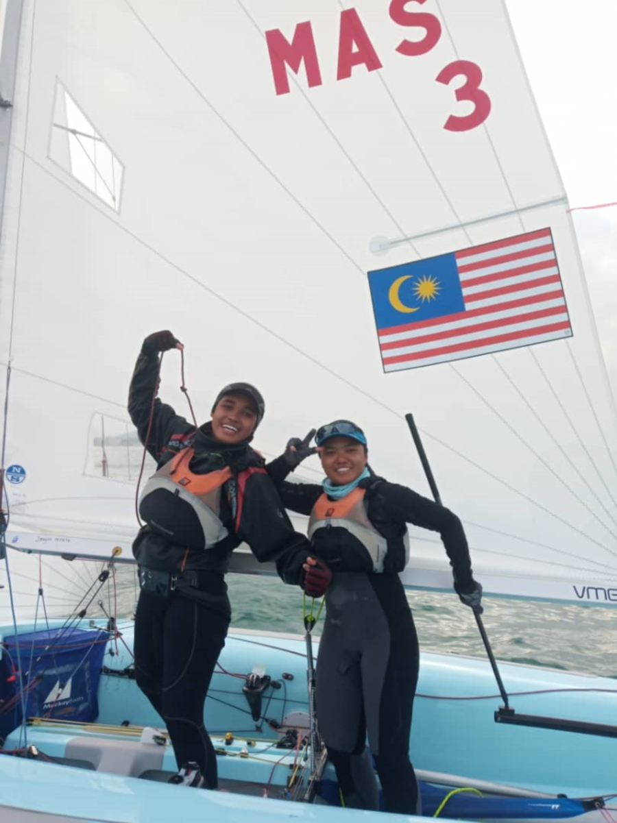 Nuraisyah Jamil and Juni Kamariah Noor Jamali in buoyant mood after finishing fifth in the Asian Championships in Shenzen, China, to qualify for the Tokyo Olympics.