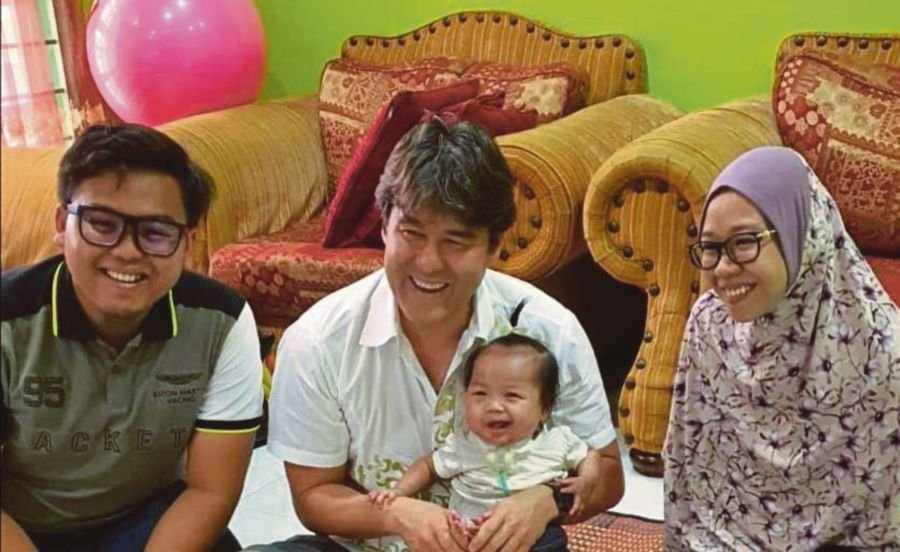 Paediatric plastic surgeon Juling Ong (second from left) holding Ainul Mardhiah Ahmad Safiuddin in Melaka recently. With them are Ainul's parents, Ahmad Safiuddin Ahmad Razak (left) and Nurul Erwani Zaidi. - Pic courtesy of Ahmad Safiuddin Ahmad Razak