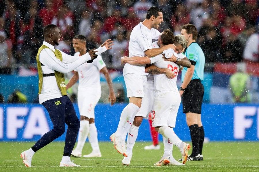 Switzerland's soccer players celebrate winning the FIFA World Cup 2018 group E preliminary round soccer match between Switzerland and Serbia in Kaliningrad, Russia, 22 June 2018. Switzerland won 2-1.