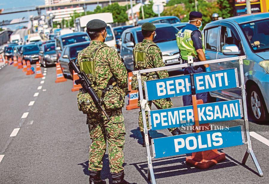 A police and army roadblock in Subang Jaya in April this year.  On March 20, three days after  the Movement Control Order was implemented, Covid-19 cases had crossed the 1,000 mark. -NSTP/File pic