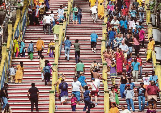 Devotees and visitors at the Batu Caves Temple yesterday. Pic by Zulfadhli Zulkifli