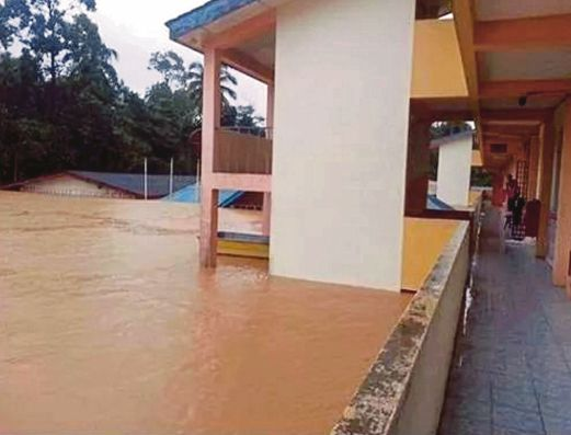 The relief centre at SMK Manek Urai, Kuala Krai, where flood waters rose up to the third floor yesterday. Evacuees have been moved to the fourth floor.