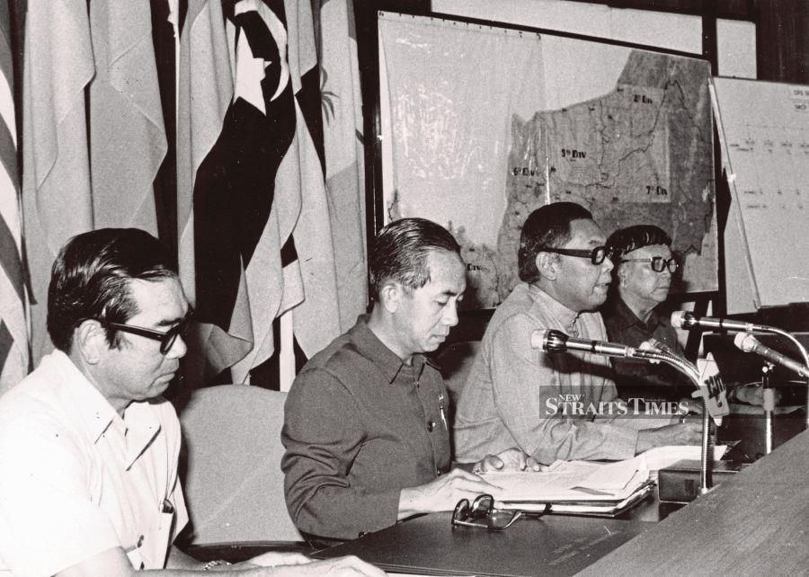 The then Sarawak chief minister  Abdul Rahman Ya'kub (second from left) announcing that 482 communists have agreed to lay down their arms in Kuching on March 4, 1974. With him are (from left) the then deputy chief minister Stephen Yong, the then home minister Mohd Ghazali Shafie and the then Sarawak affairs minister Temenggong Jugah.  FILE PIC