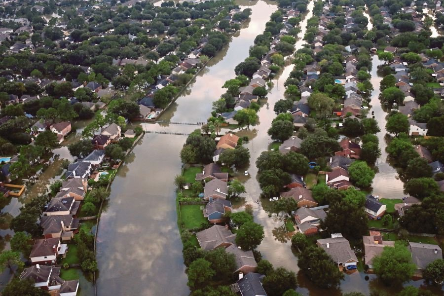 Houses partially submerged in floodwaters caused by Hurricane Harvey in Northwest Houston, Texas, last month. (REUTERS PIC)