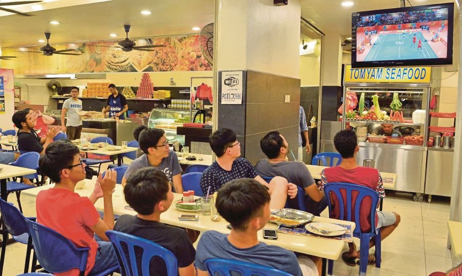 (File pix) For years mamak outlets have become places for sports enthusiasts to watch matches together.