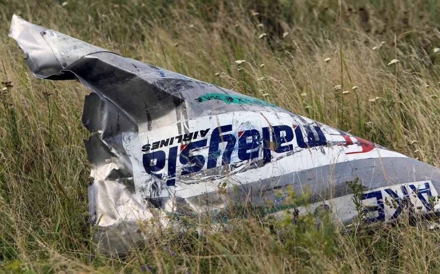 (FILE) - Part of the wreckage at the main crash site of the Boeing 777 Malaysia Airlines flight MH17, which crashed over the eastern Ukraine region, near Grabovo, some 100 km east of Donetsk, Ukraine, 20 July 2014 (reissued 25 May 2018). Australia and The Netherlands on 25 May 2018, have formally accused Russia of being responsible for the downing of Malaysia Airlines' Boeing 777 plane flight MH17, en route from Amsterdam to Kuala Lumpur, over eastern Ukraine in July 2014, resulting in the death of 298 people. EPA-EFE Photo