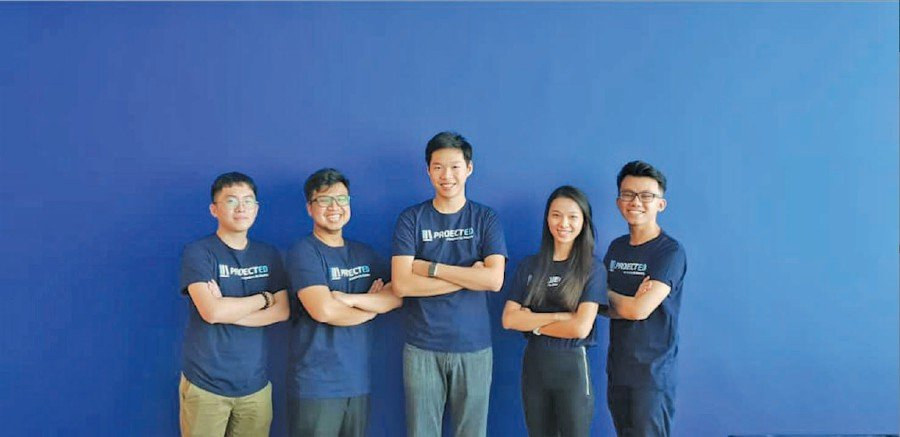 Nelson Ng Jia Jun (centre) with the board members of ProjectEd. They are (from left) Ng Soon Kiat, Al Amirul Eimer, Phung Pei Shan and Shaan Gom.