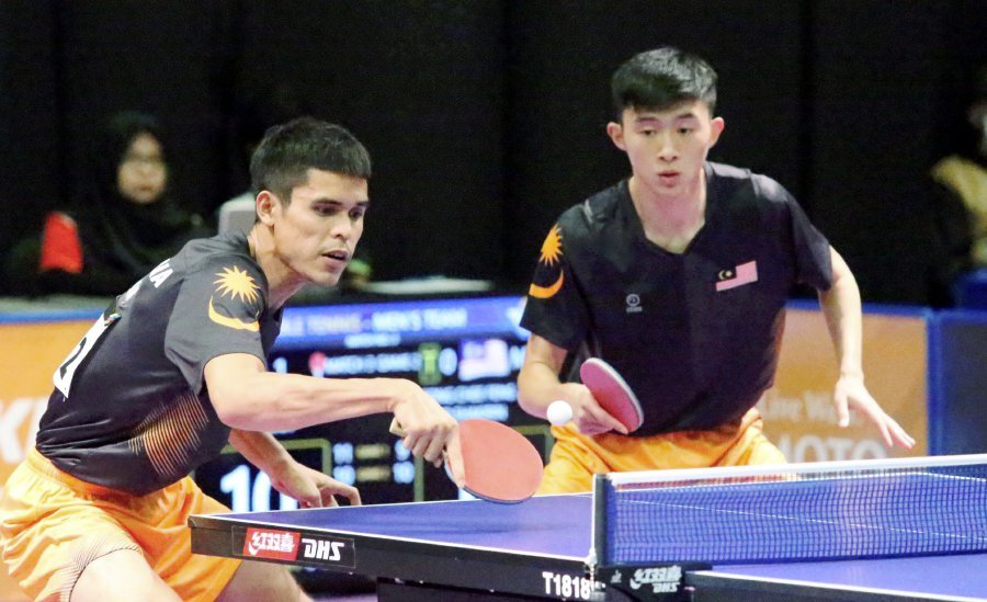 National table tennis players, Muhd Shakirin Ibrahim (left) alongside Leong  Chee Feng returning a Vietnamese team shot in the semi finals of doubles  event ... ce9faa3c70f3
