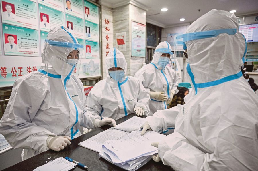 Medical staff members wearing protective clothing to stop the spread of a deadly virus at Wuhan Red Cross Hospital in Wuhan on Saturday. (AFP)