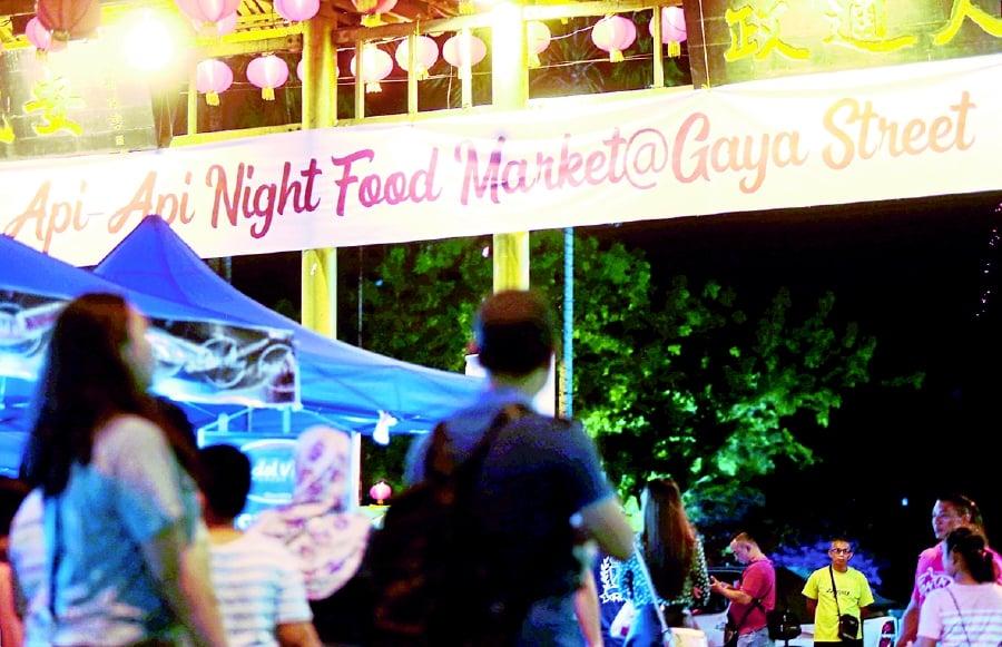 Patrons at the night market in Gaya Street, Kota Kinabalu.