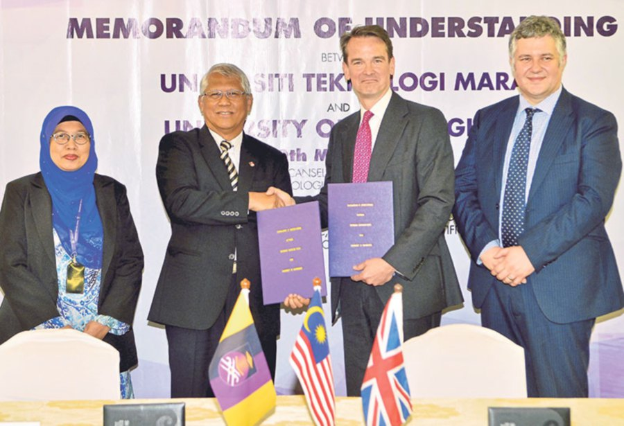 UiTM Vice-chancellor Professor Emeritus Datuk Dr Hassan Said (second from left) shaking hands with Robin Mason, flanked by Zakiah Ahmad (left) and Professor Clive Roberts, director of the Birmingham Centre for Railway Research and Education.
