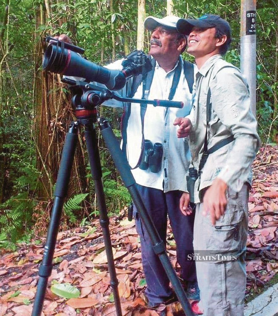 K. Sanadure (left) or fondly known as Durai Birdman or K.S Durai, is one of the country's top birding guides. PIC BY T.N. ALAGESH