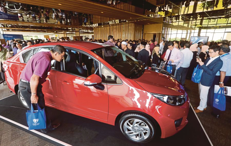 Visitors looking at the second-generation Proton Persona at the Setia City Convention Centre last year. FILE PIC