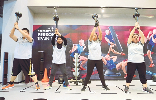 Contestants doing their exercise routine at Celebrity Fitness, Jaya One.