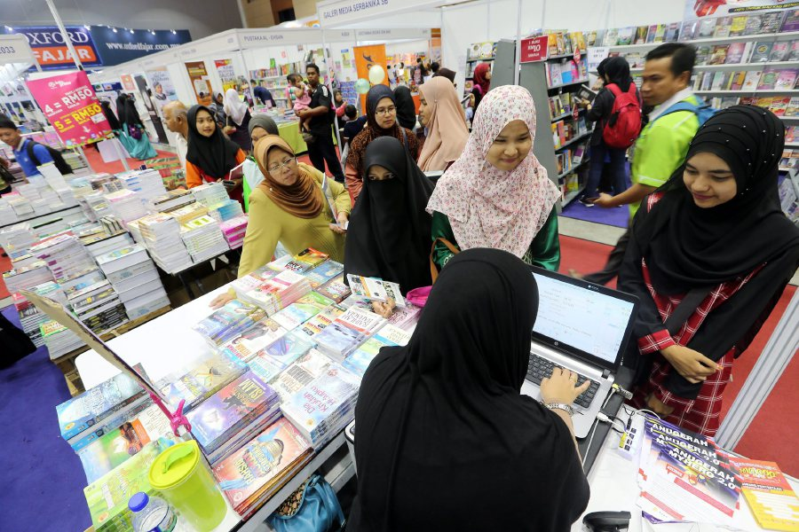 (File pix) Book Vouchers has increased the enthusiasm of students to purchase books as leisure reading and reference materials.