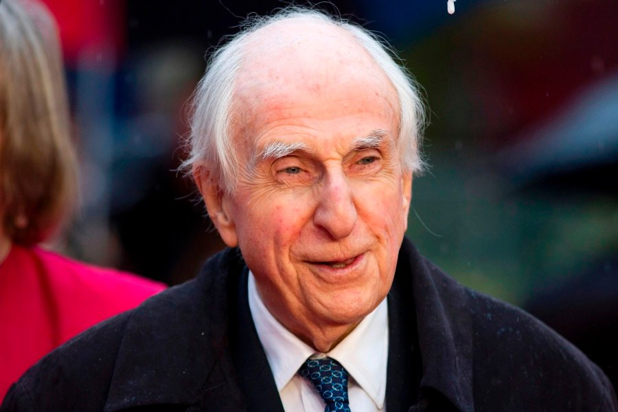 "This file photo taken on November 23, 2014 shows Michael Bond, the creator of Paddington the bear, posing for pictures on the red carpet upon arrival for the world premiere of ""Paddington"" in London.Michael Bond has died on June 27, 2017 following a short illness. AFP Photo"