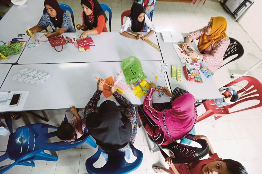 (File pix) A capacity-building class organised by Muslim Aid Malaysia for Rohingya refugees is in session. Pix by Munira Abdul Ghani