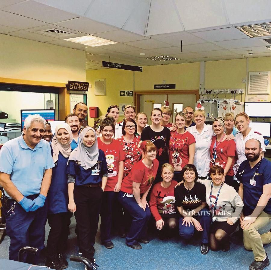 Dr Farah Shaheera Roslan (front row, third from left) with colleagues at the Accident and Emergency Department of Pilgrim Hospital Boston in Lincolnshire, the United Kingdom, on Christmas day.