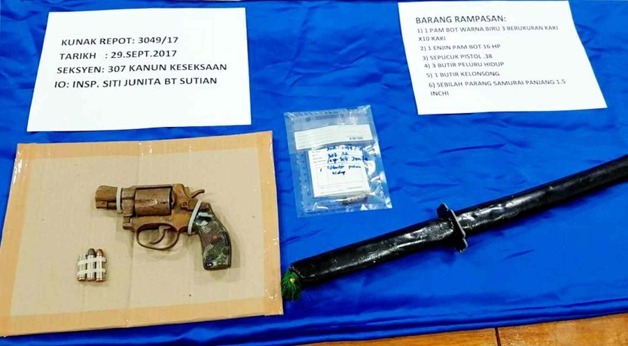 Police seized a .38 revolver, three bullets, and a sword during the incident. Pix by Abdul Rahemang Taiming