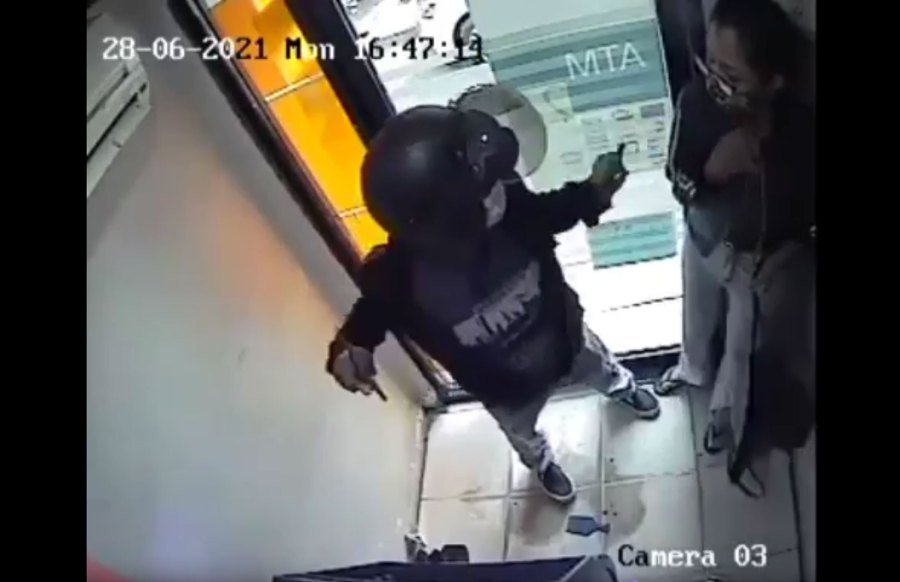 A video footage showing a robbery within an enclosed automated teller machine (ATM) facility did not happen in the state capital.-Pic courtesy of readers.