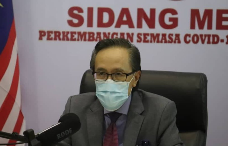Sabah Covid-19 spokesman Datuk Seri Masidi Manjun said restricting people's movement would not be the only way out from the situation and it was no longer effective in containing the infection. -File pic