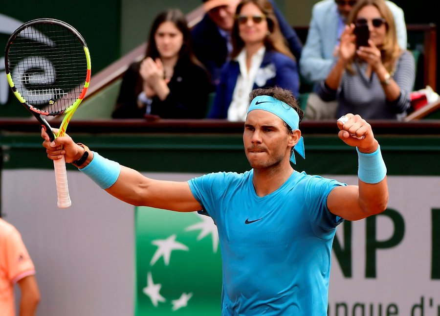 c4322d8e45ee Rafael Nadal of Spain reacts after winning against Simone Bolelli of Italy  during their men s first round match during the French Open tennis  tournament at ...
