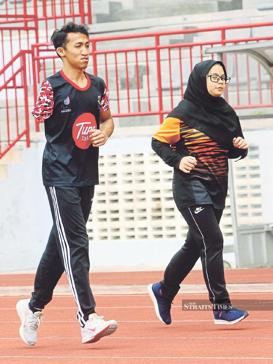 Ahmad Solihim Mohd Nor (left) and Nur Syahmina Aisyah Azmi are among the disabled athletes pursuing a bachelor's degree in sport management science.- NSTP/Rosdan Wahid