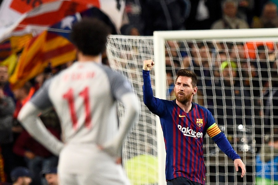 0a8a3efe5 Barcelona s Argentinian forward Lionel Messi celebrates a goal in front of  Liverpool s Egyptian forward Mohamed Salah during the UEFA Champions League  ...