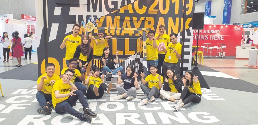 Maybank apprentice Elisa Naomi Tibok (sitting, second from right) with her team members.