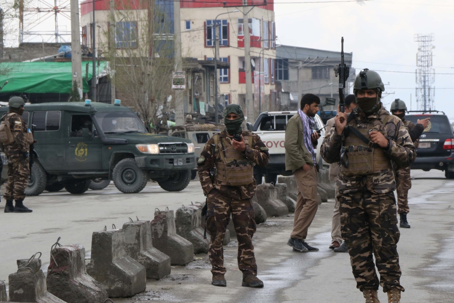 Afghan security personnel stand guard near the site of an attack to a Sikh temple in Kabul. -AFP pic