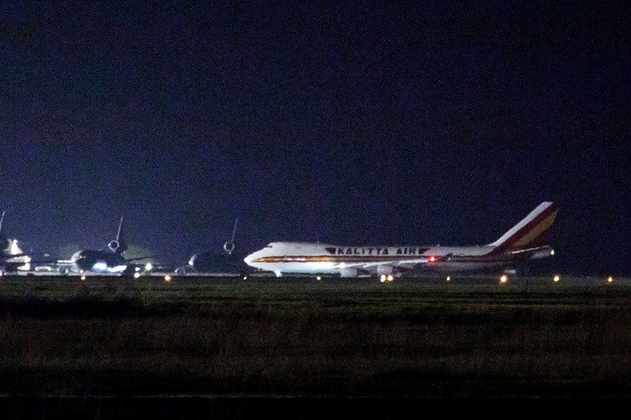 A plane carrying American passengers, who were recently released from the Diamond Princess cruise ship in Japan, arrives at Travis Air Force Base in California. -AFP