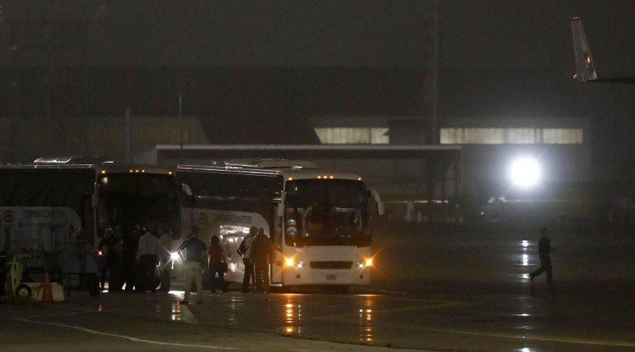 American evacuees from the Diamond Princess cruise ship board buses at Joint Base San Antonio-Lackland on February 17, 2020 in San Antonio, Texas. -AFP