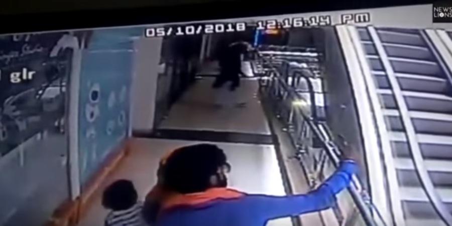 Watch: Woman taking selfie on escalator loses grip on