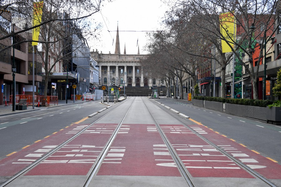 A near empty street scene is seen in Melbourne, Victoria, Australia, 18 July 2021. Victoria is in day three of its latest COVID-19 lockdown as health authorities race to keep up with fleeting transmission of the virus. EPA/JAMES ROSS