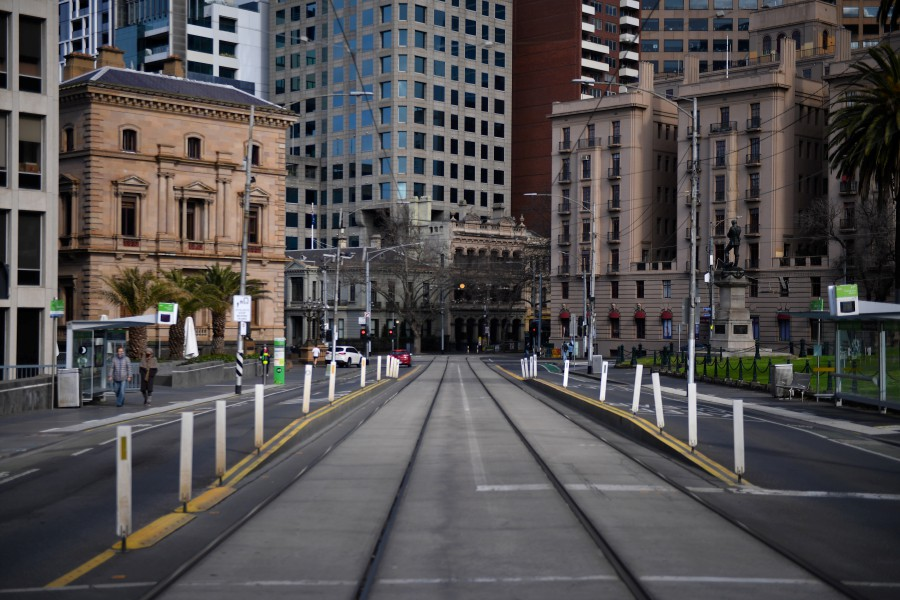 A near empty street scene is seen in Melbourne, Victoria, Australia, 18 July 2021. Victoria is in day three of its latest COVID-19 lockdown as health authorities race to keep up with fleeting transmission of the virus. - EPA/JAMES ROSS