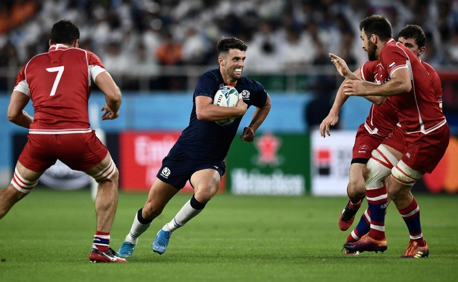 Scotland's fly-half Adam Hastings (centre) runs with the ball during the Japan 2019 Rugby World Cup Pool A match between Scotland and Russia at the Shizuoka Stadium Ecopa in Shizuoka. - AFP