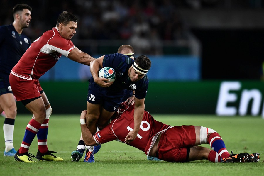 Scotland's hooker Stuart McInally is tackled during the Japan 2019 Rugby World Cup Pool A match between Scotland and Russia at the Shizuoka Stadium Ecopa in Shizuoka. - AFP