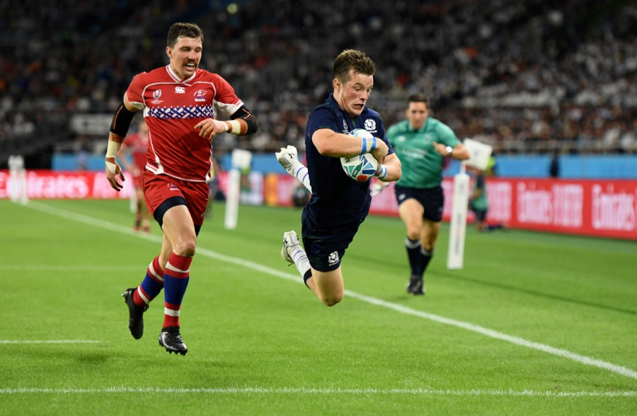 Scotland's George Horne scores their seventh try. - Reuters