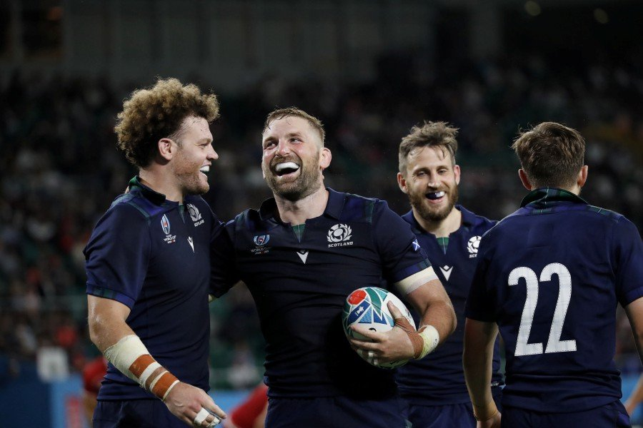 Scotland's John Barclay (centre-left) celebrates with teammates during the Rugby World Cup match between Scotland and Russia at the Shizuoka Stadium in Fukuroi, Japan. - EPA