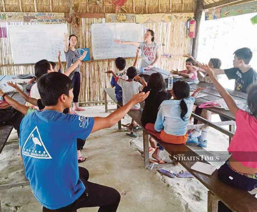 IB Diploma students from Taylor's College Sri Hartamas doing community service in Cambodia to fulfil the CAS component of their studies. File Pic