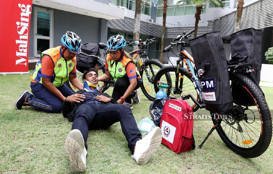 """""""For example, when there are events such as Fun Run, Fun Ride or other marathons, we cannot use our ambulance to reach the victim on time. That is when this bicycle would come in handy as a first respondent,"""" Putrajaya Disaster Management deputy director Mohd Rosman Abdullah said when met at Mah Sing Group Bhd's Northern Region office here today. - NST/ MIKAIL ONG"""