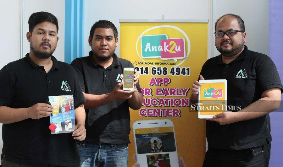 The trio (from left) Muhammad Arif Omar, Aniq and Wan Muzaffar developed the app as a solution for early education centres.