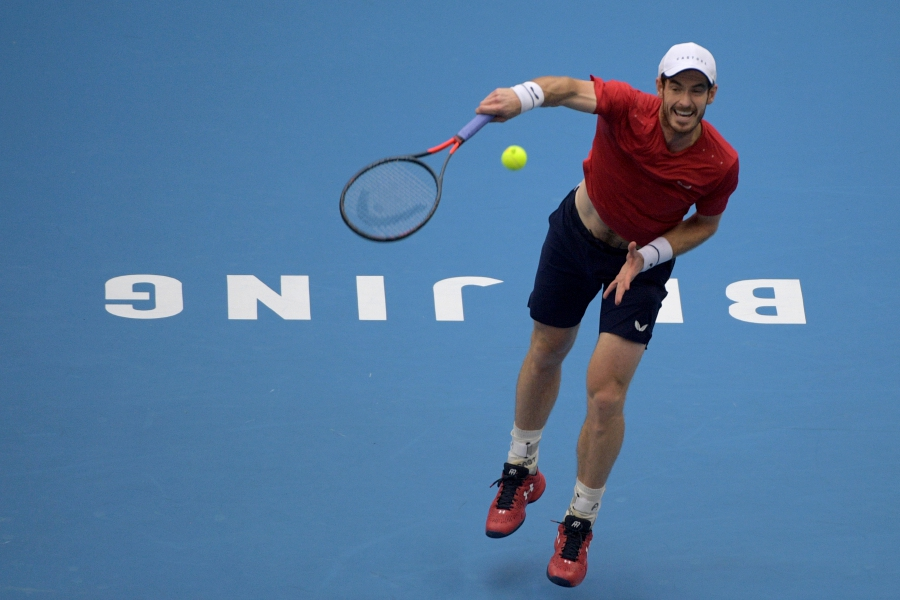 Andy Murray of Britain serves during his men's singles quarter-final match against Dominic Thiem of Austria at the China Open tennis tournament in Beijing on October 4, 2019. (Photo by NOEL CELIS / AFP)